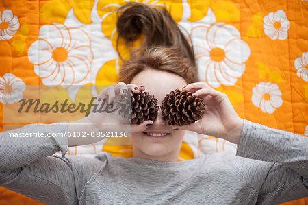 Girl holding pine cones