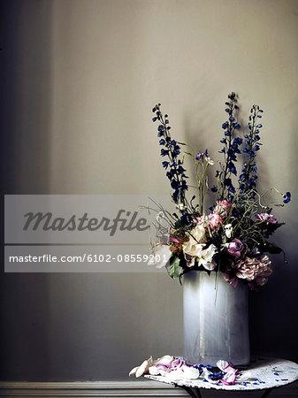 Flowers in vase against grey wall