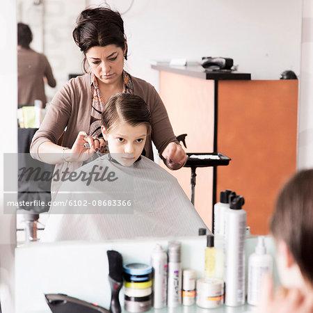 Boy at hairdresser