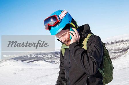 Skier talking via cell phone