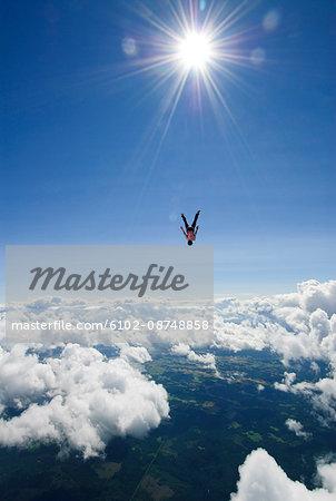 Scandinavia, Sweden, Uppland, Skydiver flying mid-air