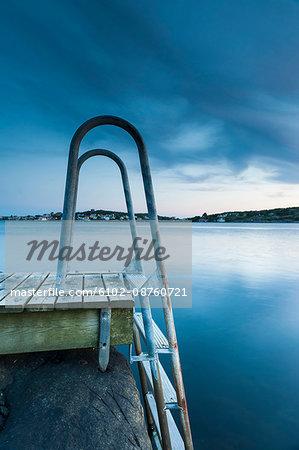 Swim ladder on jetty at dusk