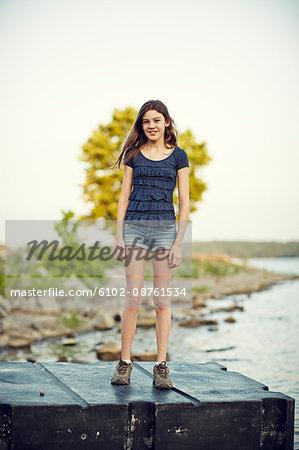 Teenage girl standing at water