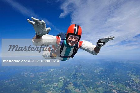 Aerial shot of man skydiving