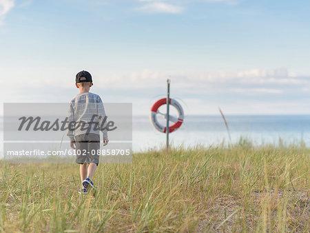 Boy walking on meadow