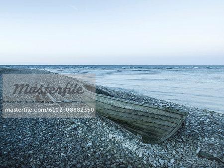 Rowing boat on pebble beach