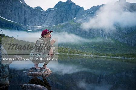 Woman at lake brushing teeth
