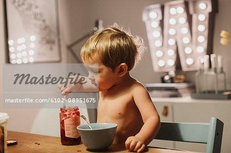 Boy eating jam