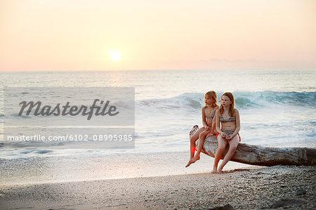 Girls on beach at sunset