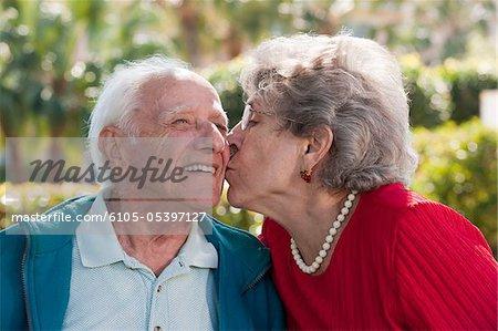 Senior couple romancing in a park