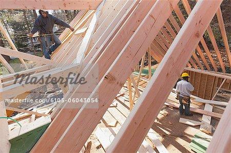 Carpenter measuring house dormer
