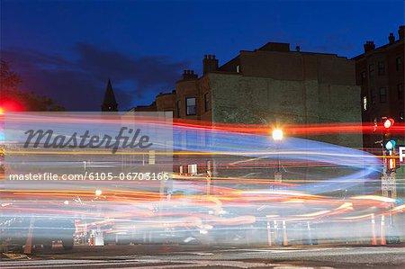 Cars on the road at dusk, Newbury Street, Boston, Massachusetts, USA
