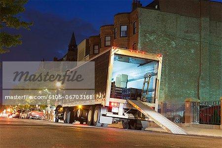Unloading service truck at dusk, Newbury Street, Boston, Massachusetts, USA