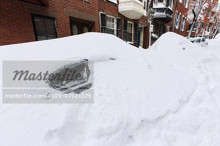 Snowbound auto on Mount Vernon Street after blizzard in Boston, Suffolk County, Massachusetts, USA