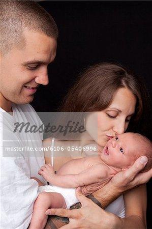 Family Loving Newborn Baby