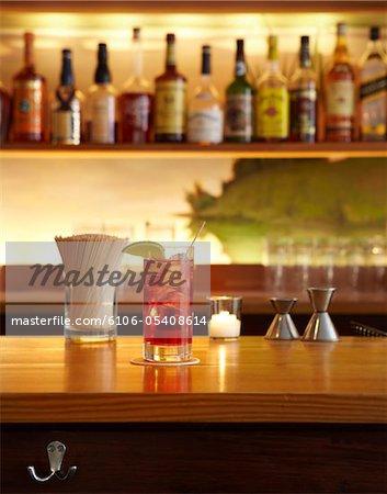 Mixed drink served at bar.