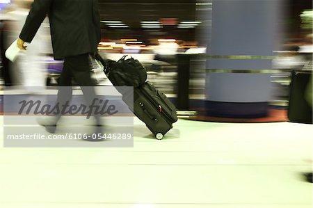 Businss Class Traveler at airport with motoin blur
