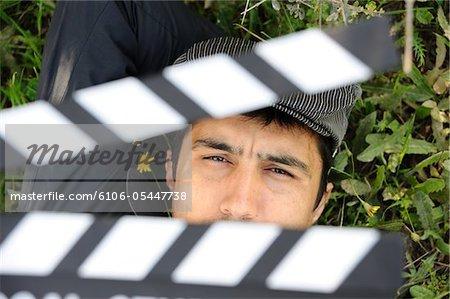 Man behind a clapperboard
