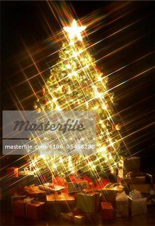 Presents around illuminated Christmas tree