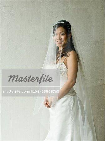 Bride standing, portrait