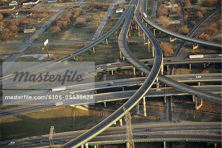 Traffic on cloverleaf overpass, aerial view