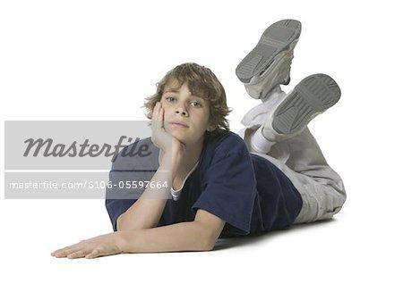 Portrait of a boy lying on the floor