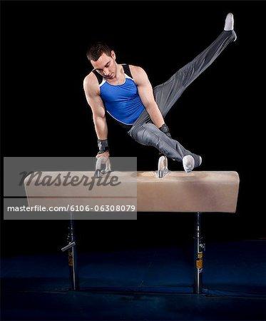 Gymnast performing on pommel horse