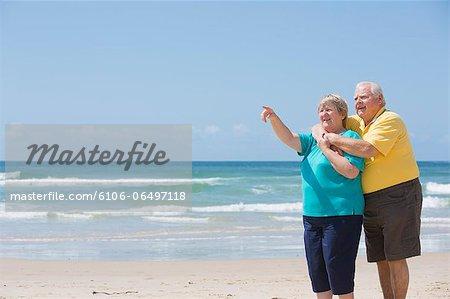 Seniors Enjoying Beach View