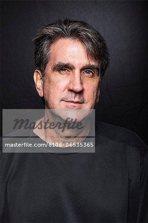 Portrait of mature man in black