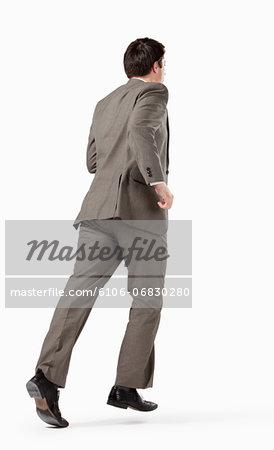 Business man running away from camera