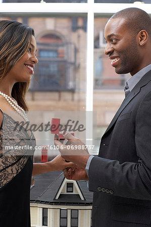 Man proposing to woman, close-up