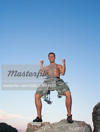 Rock Climber Celebrates on a Mountain Peak