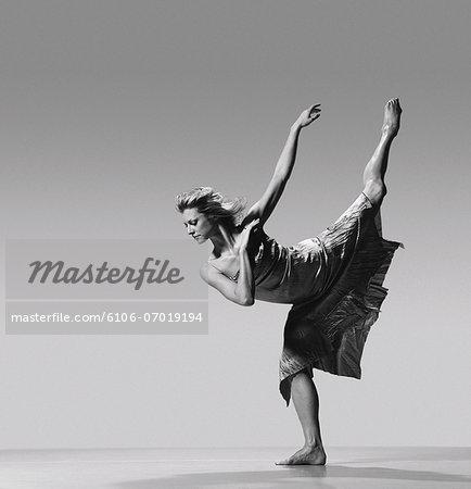 Female Dancer Standing on One Leg and Bending Over