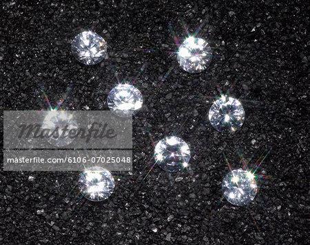 Small diamonds sparkling in black sand