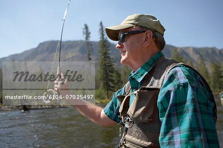 Senior man flyfishing