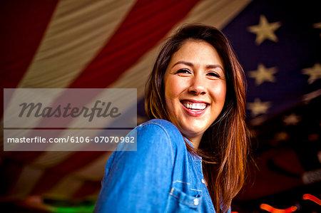 Portrait of a young women inside a bar having fun.
