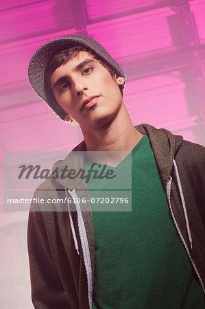 Teenage boy in foggy warehouse, portrait