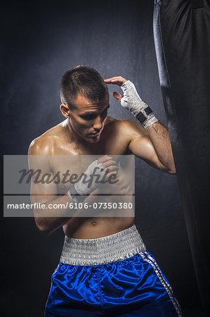 Male boxer hitting a punching bag