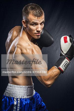Portrait of male boxer in guard