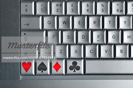 Computer keyboard with playing card symbol keys