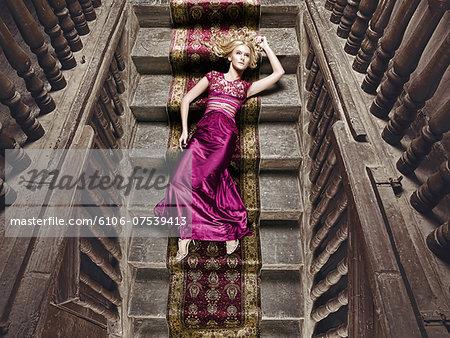 Beautiful woman lying on a silk rug