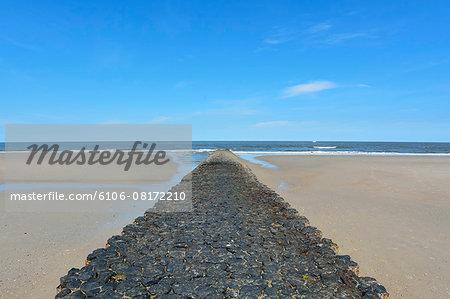 North Sea with Basalt Stone Breakwater