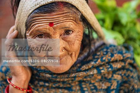 Nepali woman selling vegetables in Patan