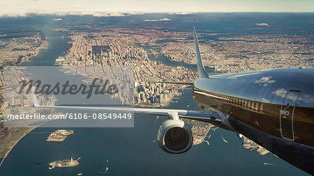Commercial jet over Manhattan