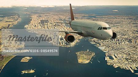 Commercial jet flying over Manhattan