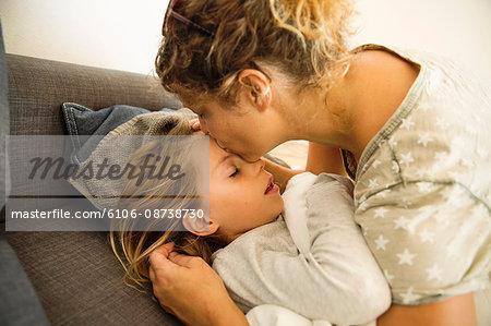 Mother kissing her girl