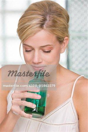 Woman smelling aromatherapy oil