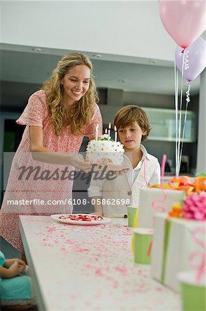 Woman holding a birthday cake