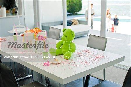 Teddy bear and birthday presents on a table
