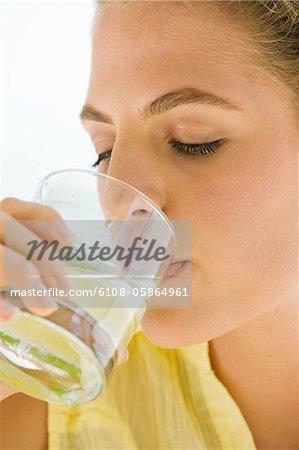 Close-up of a woman drinking lemonade